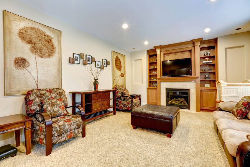 27261989 - furnished luxury living room with leather ottaman  view of fireplace with tv and built-in cabinet