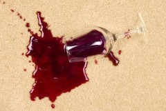 5885578 - a glass of spilled wine on brand new carpet is sure to leave a stain.