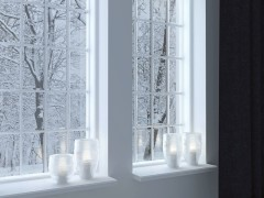 28252658 - cozy room. candlesticks on a windowsill. winter landscape through the window.