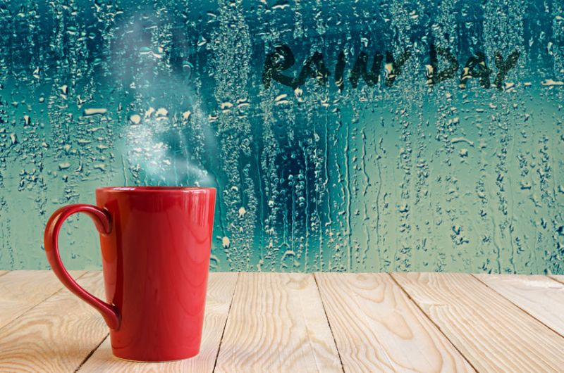 41532129 - red coffee cup with smoke  on water drops glass window background