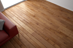 30533035 - wooden floor texture with red leather couch and pillow