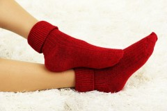 17521145 - female legs in colorful socks on  white carpet background