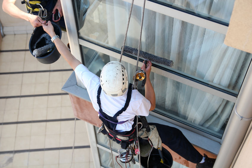 26620197 - climbers washing windows - teamwork