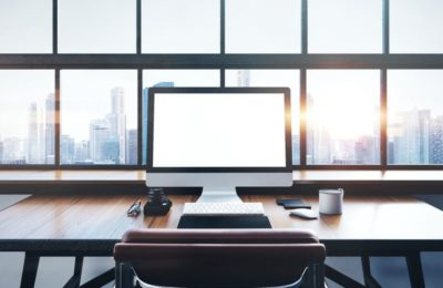 46966161 - photo of generic design computer screen and workspace in loft with panoramic windows and city on the background