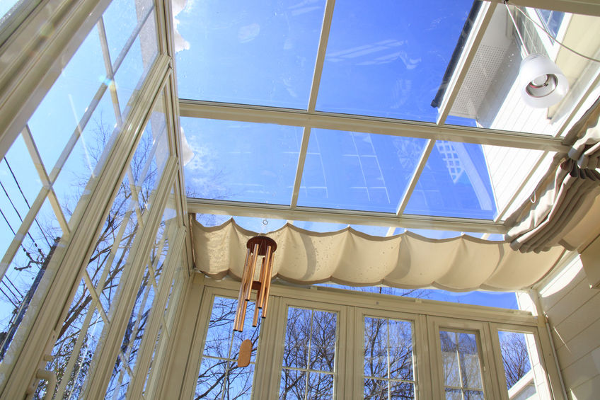 47184829 - blue sky visible from the sunroof of the conservatory