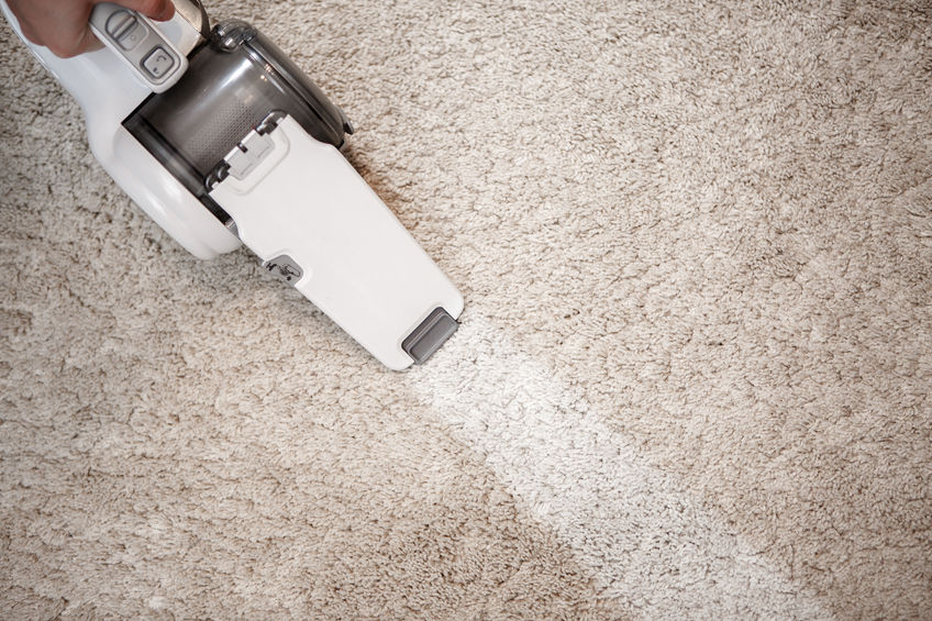63296408 - dusty carpet and clean stripe after clearing cordless handheld vacuum cleaner