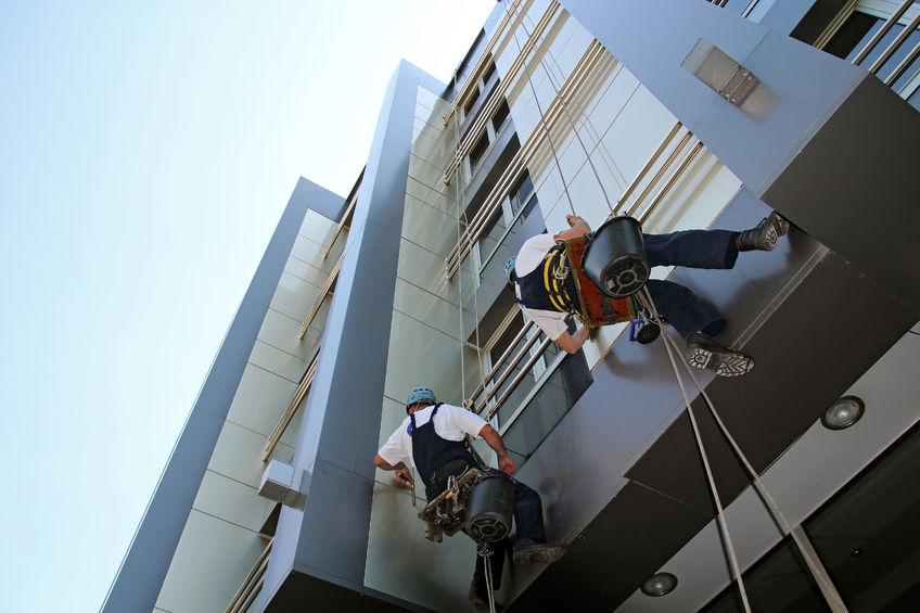 26620210 - workers washing the windows facade of a modern office building